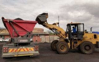JCB loading a side tipper truck
