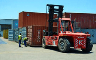 Container hoist stacking containers
