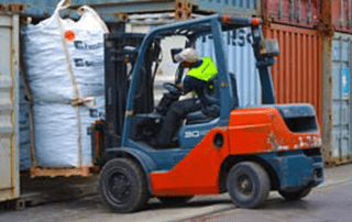 Forklift driver busy stacking cargo