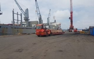 Truck moving cargo to container ship