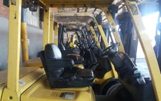 Yellow forklifts in a line
