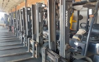A row of forklifts
