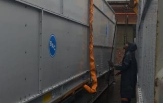 Container being loaded onto truck